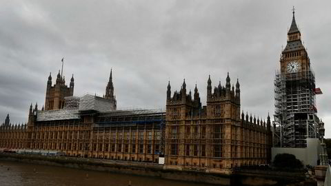 Scaffolding stands around the London landmark Big Ben, almost up to the clock face, in London, Wednesday, Oct. 11, 2017. A programme of essential works to conserve the Elizabeth Tower, the Great Clock and the Great Bell, also known as Big Ben is now estimated at 61 million pound as opposed to 29 million pound as estimated in spring 2016. (AP Photo/Kirsty Wigglesworth)
