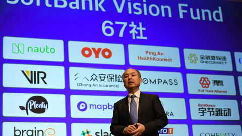 Softbank group CEO Masayoshi Son delivers a speech during his company's financial results press conference at a hotel in Tokyo on November 5, 2018. - Son on November 5 condemned the killing of Saudi journalist Jamal Khashoggi, but indicated he would continue to do business with Saudi Arabia. (Photo by Toshifumi KITAMURA / AFP)