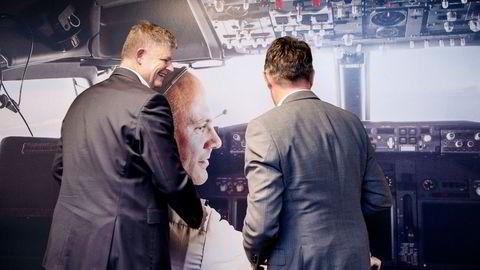 Konsernsjef Jacob Schram (til venstre) og finansdirektør Geir Karlsen har tro på at en ny forretningsplan og medvirkning fra regjeringen skal få Norwegian gjennom rekonstruksjonsprosessen.