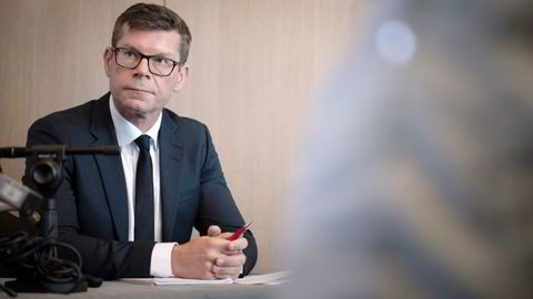 Konkurransetilsynet og avdelingsdirektør Gjermund Nese ser på DNBs forsøk på å kjøpe Sbanken.