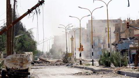 Etter syv måneders kamp greide i helgen den syriske hæren støttet av russisk luftvåpen å vinne tilbake oldtidsbyen Palmyra. Foto: Afp/NTB Scanpix