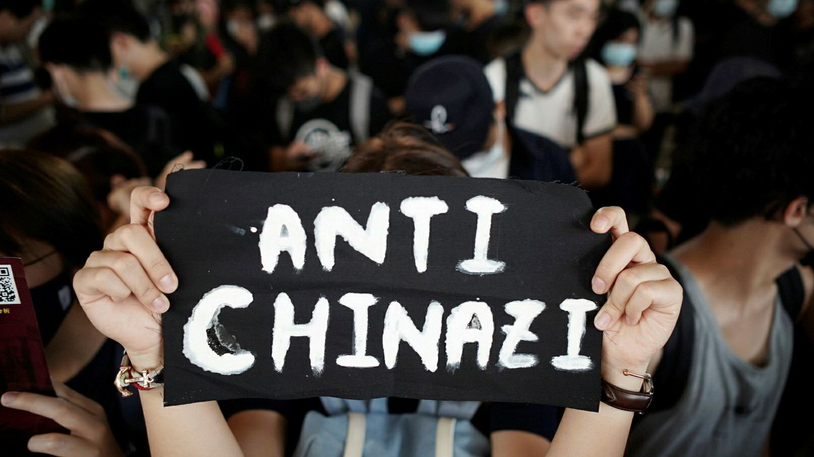 A woman holds up a message as she gathers with other at West Kowloon Law Courts Building to show their support to the 96 anti-government protesters who were arrested days ago in Hongkong, China, October 2, 2019. REUTERS/Athit Perawongmetha