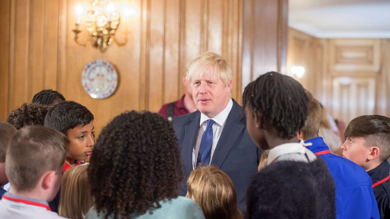 British Prime Minister Boris Johnson takes questions from children aged 9-14 during an education announcement inside Downing Street in London, Britain, August 30, 2019. Jeremy Selwyn/Pool via REUTERS