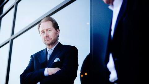 FUSJONERER. Kjell Inge Røkke (th) kontrollerer Det norske gjennom Aker. FOTO: Fartein Rudjord