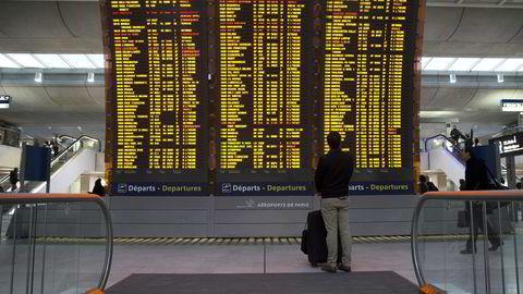 Flyselskapene ble oppfordret til å innstille en femtedel av alle flyvninger på grunn av streik blant franske flyveledere tirsdag. Bildet er fra flyplassen Roissy Charles-de-Gaulle tidligere på dagen tirsdag. Foto: AFP/KENZO TRIBOUILLARD/NTB SCANPIX