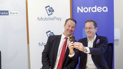 GÅR SAMMEN. Fra dagens pressekonferanse med Danske Banks Norgessjef Trond F. Mellingsæter (t.v.) og  Nordea Norge-sjef Snorre Storset. Foto: Javad Parsa