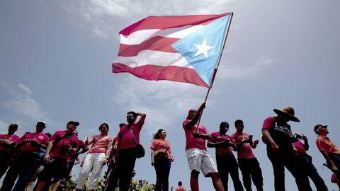 Puerto Rico har misligholdt sin statsgjeld i over et år. Bildet viser en demonstrasjon i hovedstaden San Juan ifjor. Foto: Alvin Baez/Reuters/NTB Scanpix