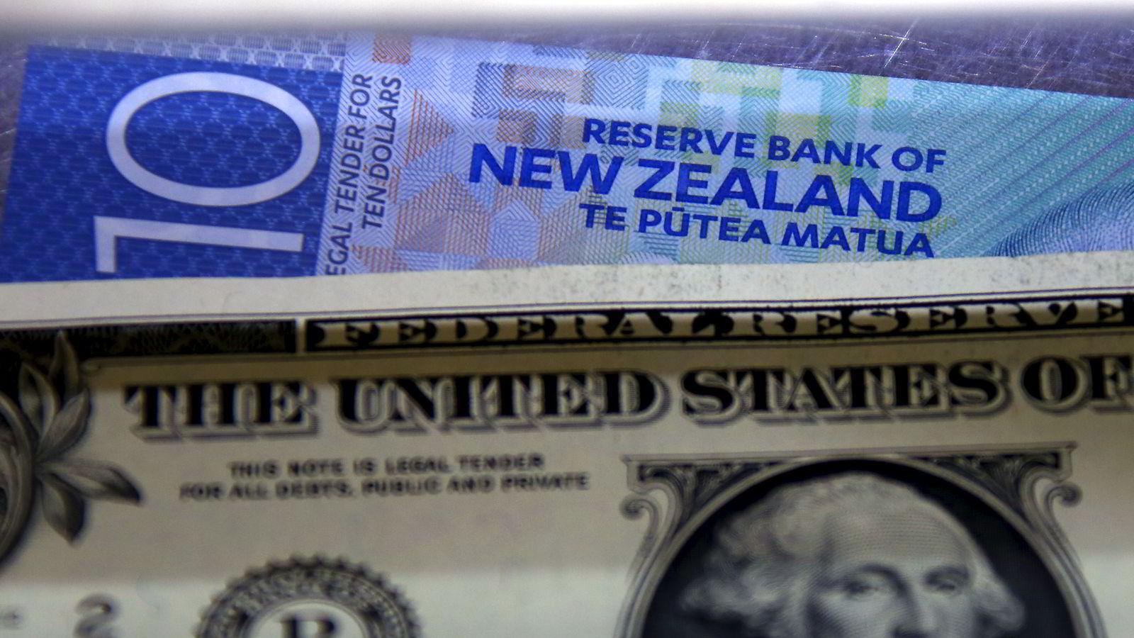 New Zealands sentralbank kutter overraskende renten, noe som sendte landets egen valuta nedover samennlignet med den amerikanske dollaren. Foto: David Gray/Reuters/NTB Scanpix.