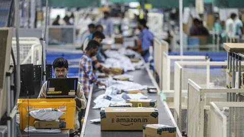 Hva skjer når Amazon inntar Skandinavia, spør kronikkforfatteren. Bildet er fra Amazon.com i Hyderabad i India, hvor selskapet har åpnet sin største pakkesentral.