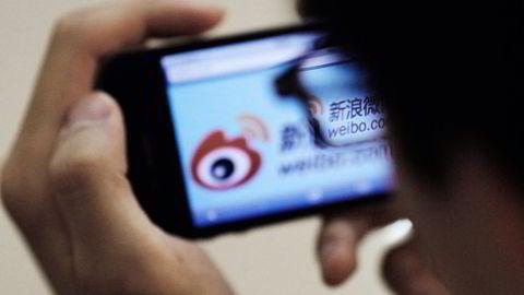 PÅ BØRS. Over 500 millioner kinesere er registrert som brukere av Weibo. Nå skal lynmeldingstjenesten børsnoteres i New York.                    Foto: Carlos Barrio, Reuters/NTB Scanpix