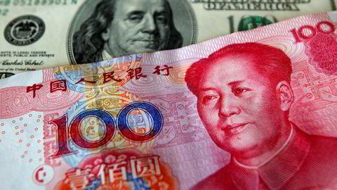 Kina kan manipulere sin egen valuta for å svekke virkningene av amerikanernes toll. Foto: Nicky Loh, Reuters/NTB Scanpix