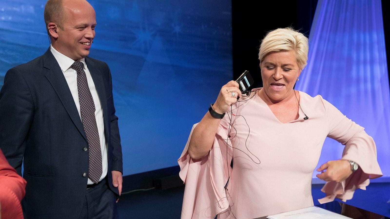 Trygve Slagsvold Vedum (Sp) og Siv Jensen (Frp) kroner hverandre til dronning og konge av eiendomsskatt.