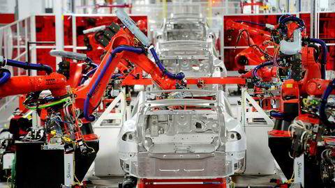 Tesla er ikke bare en billeverandør, de er i batteribransjen, infrastrukturbransjen, og mest av alt, i teknologibransjen. Foto: Noah Berger/Reuters/NTB Scanpix