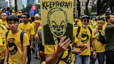 Korrupsjonsanklager var sterkt medvirkende til at statsminister Najib Razak, her karikarurtegnet, tapte valget og måtte gå av tidligere i år.