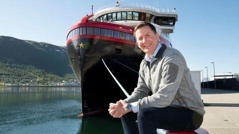 Det nye hurtigruteskipet «Roald Amundsen» ligger til kai i Tromsø. Konsernsjef i Hurtigruten, Daniel Skjeldam, sier at skipet vil være svært lønnsomt.
