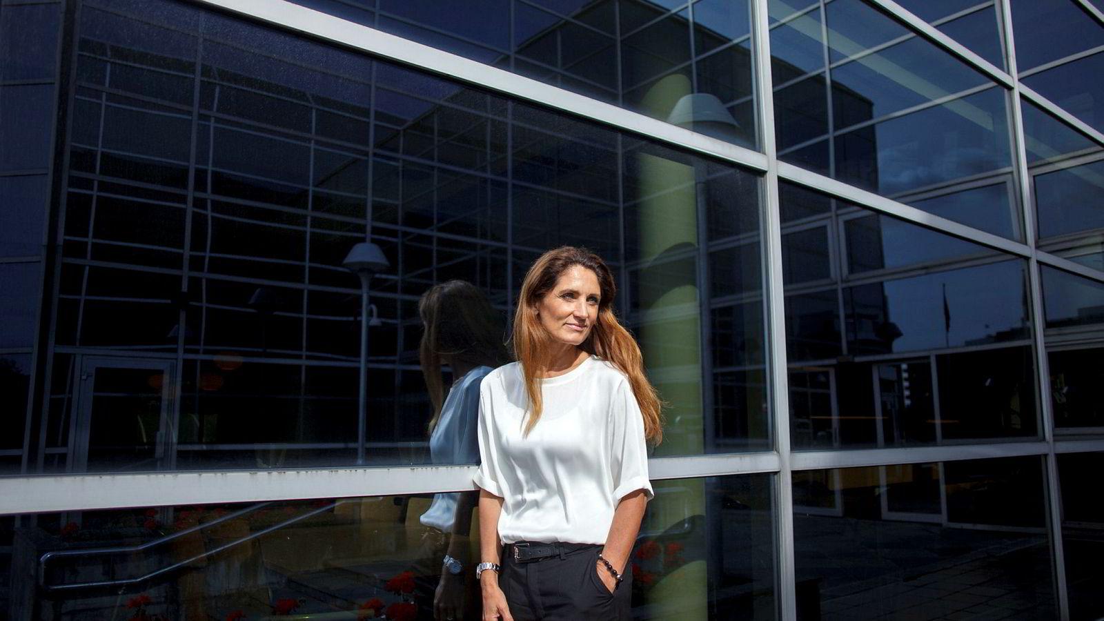 Administrerende direktør Tine Wollebekk i Bank Norwegian har levert en stabil, god fortjeneste på forbrukslån og kredittkort, og overskuddet før skatt var 1,2 milliarder kroner etter første halvår i år. Fra 2019 kan låneveksten begrenses av strengere regler.