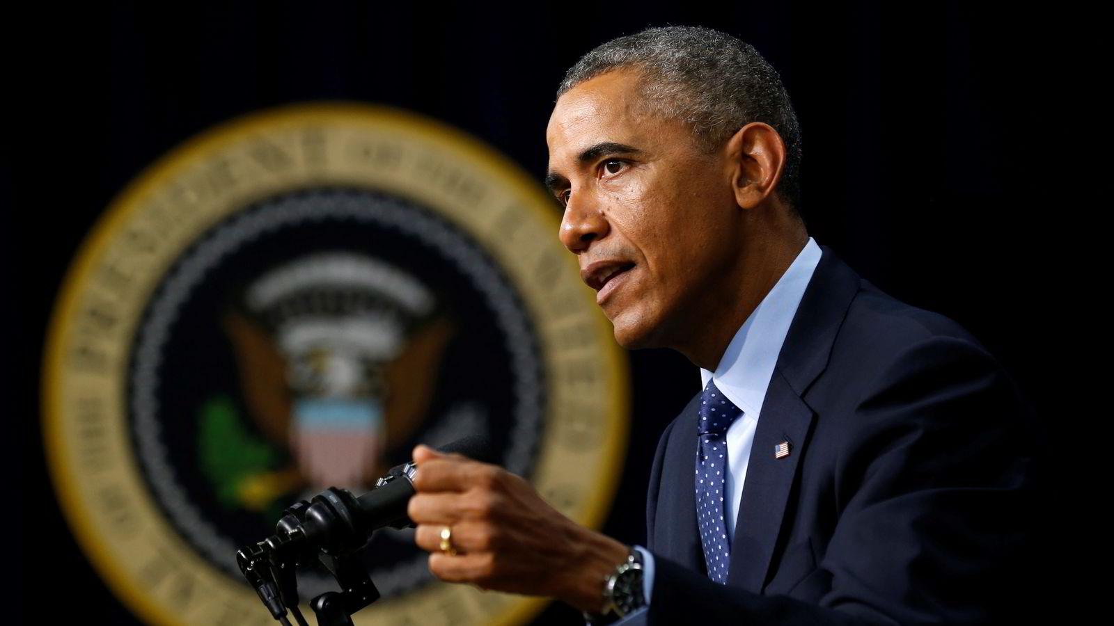 I uvisse tider ser verden til USA og landets verdier som frihet og demokrati, sa Obama lørdag i sin ukentlige tale. Foto: Kevin Lamarque/Reuters/NTB scanpix