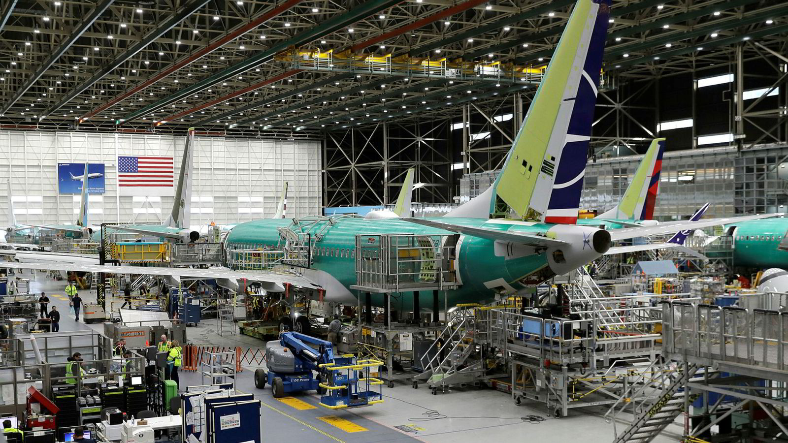FILE - In this March 27, 2019, file photo people work on the Boeing 737 MAX 8 assembly line during a brief media tour in Boeing's 737 assembly facility in Renton, Wash. On Wednesday, May 1, the Institute for Supply Management, a trade group of purchasing managers, issues its index of manufacturing activity for April. (AP Photo/Ted S. Warren, File)