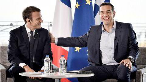 Statsminister Alexis Tsipras (til høyre) har en formidabel oppgave foran seg når Hellas fremover skal klare seg uten krisehjelp. Her sammen med Frankrikes president Emmanuel Macron, som besøkte Aten i september i fjor.