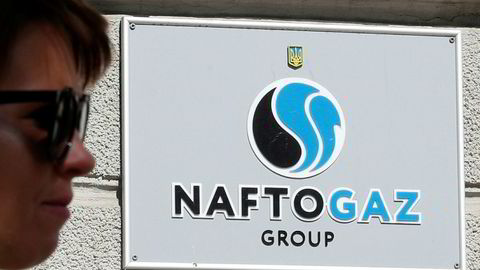 A woman walks past the headquarters of the Ukrainian state energy company Naftogaz in central Kiev, Ukraine September 13, 2019. REUTERS/Valentyn Ogirenko