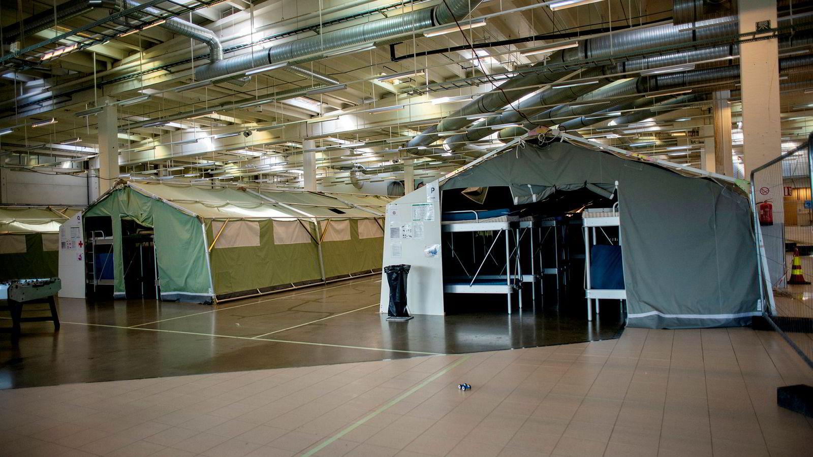 Ankomstsenter Østfold er lokalisert i de gamle butikklokalene til Smart Club i Råde kommune i Østfold, og er i ferd med å bli satt i stand til å bli mye mer enn et første oppholdssted for asylsøkere, skriver artikkelforfatteren.