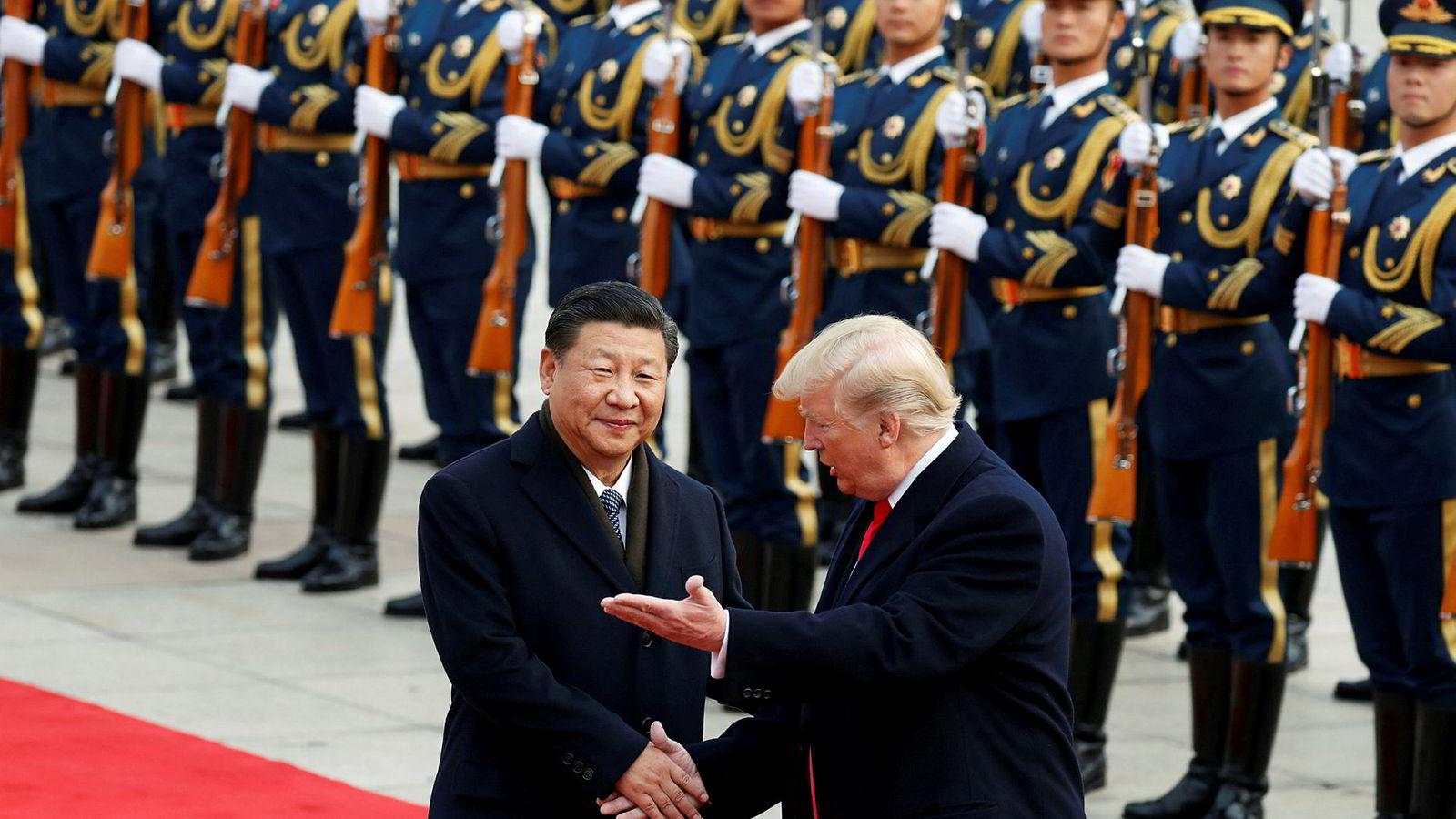 Kinas president Xi Jinping antyder at handelskrigen med USA og Donald Trump kan vare. Her fra et tidligere møte mellom de to i Beijing.