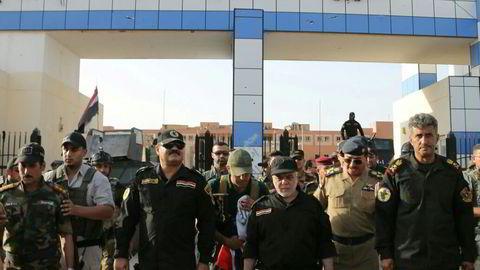 Iraks statsminister Haider al-Abadi under et besøk i Falluja i slutten av juni. Foto: Den irakiske statsministerens kontor / Reuters / NTB scanpix
