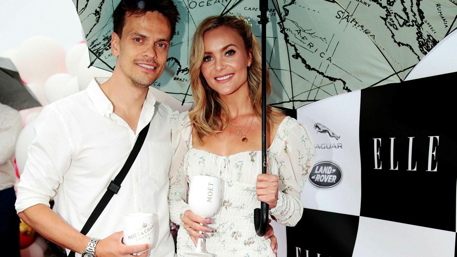 Lars-Kristian Eriksen og Caroline Berg Eriksen på den røde løperen til Elle-festen på Akershus festning tidligere i sommer.