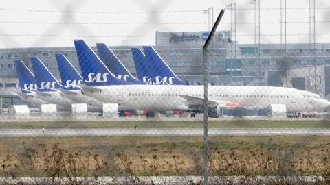 Pilotstreiken i slutten av april og tidlig i mai rammet SAS hardt og 400.000 passasjerer ble berørt. Her parkerte fly på Oslo lufthavn under streiken.