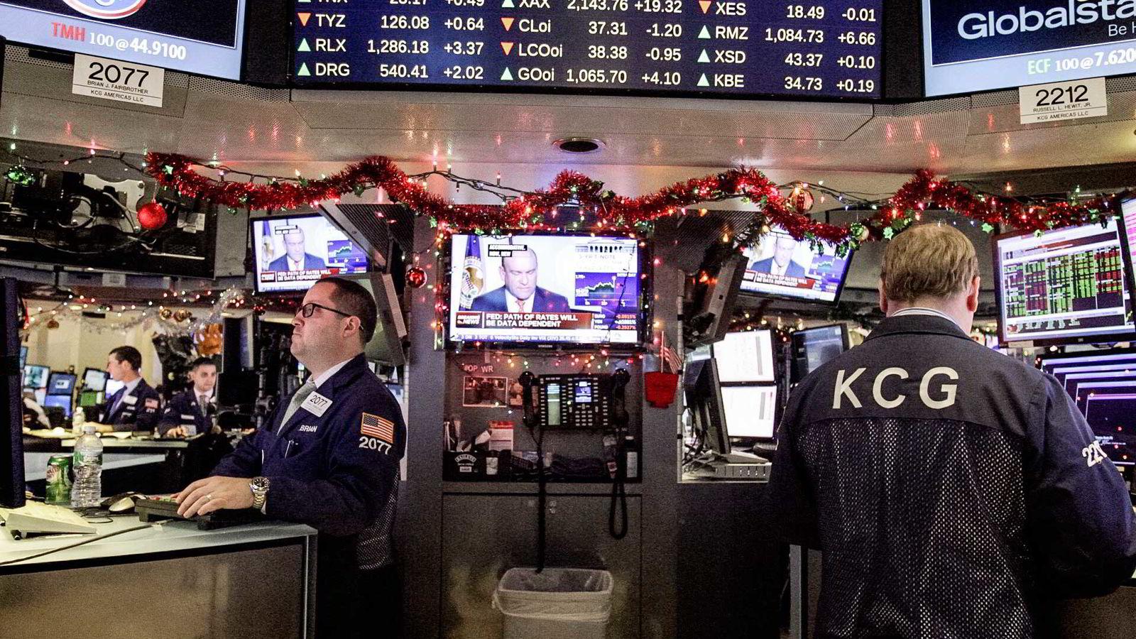 Meglere på gulvet til NYSE reagerer på beskjeden fra rentemøtet.