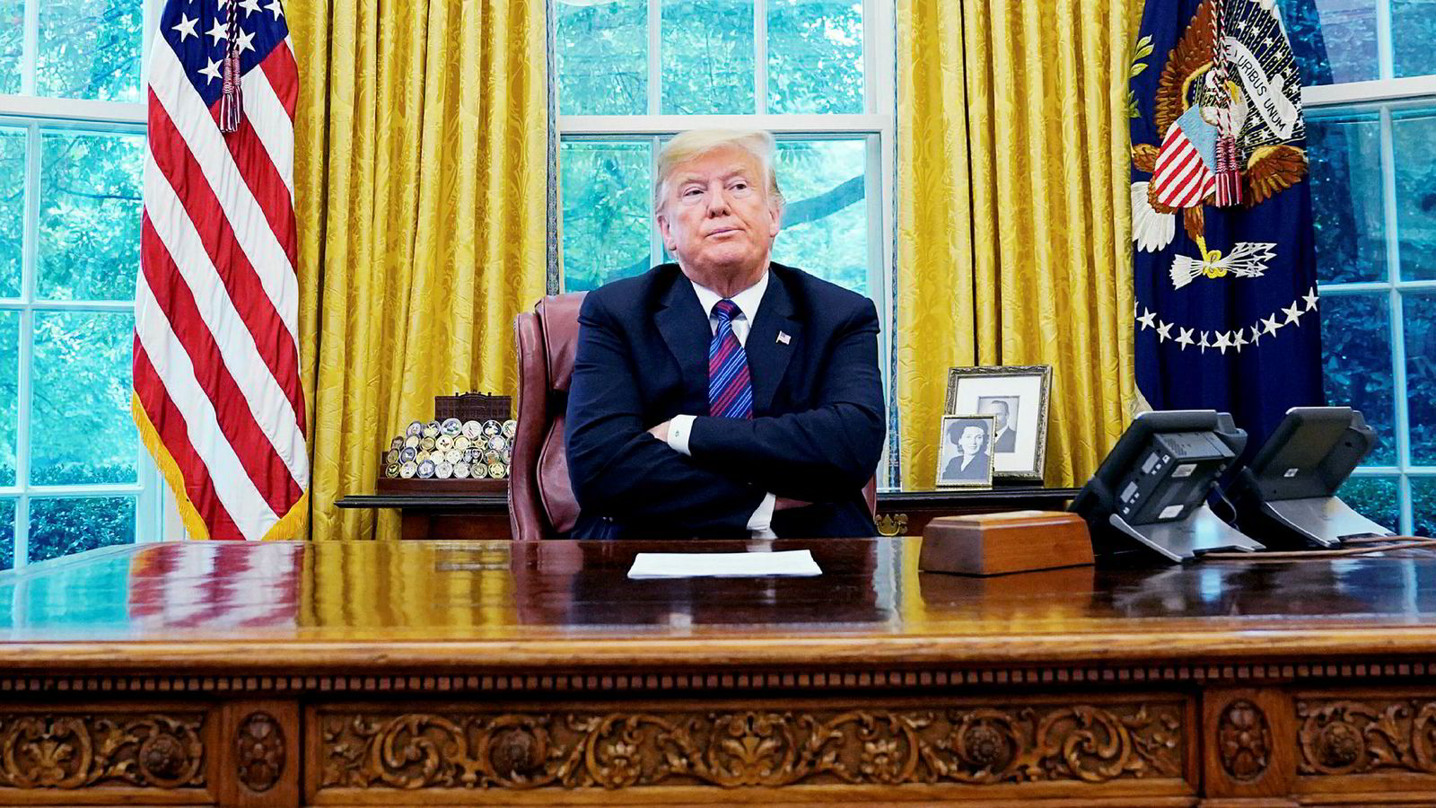 Frihandel er i det store og hele gunstig, men faktum er at ulikheten har tiltatt etter hvert som handelen er blitt friere. Her USAs presidenten Donald Trump i Det hvite hus i Washington.