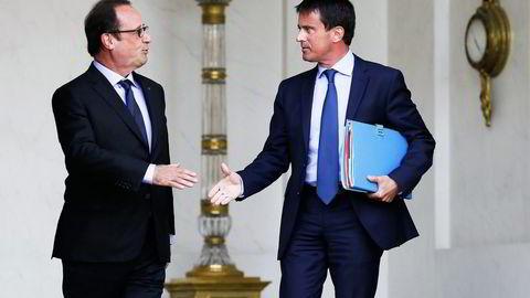 Fortsetter sparepolitikk. President François Hollande (til venstre) har bedt statsminister Manuel Valls legge ny regjeringskabal i dag, uten rebelske venstrevridde ministre. Foto: Patrick Kovarik, AFP/NTB Scanpix