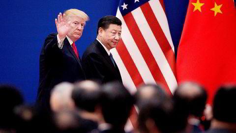 USAs president Donald Trump under et møte i fjor med Kinas president Xi Jinping. De to landene er nå engasjert i en handelskrig.