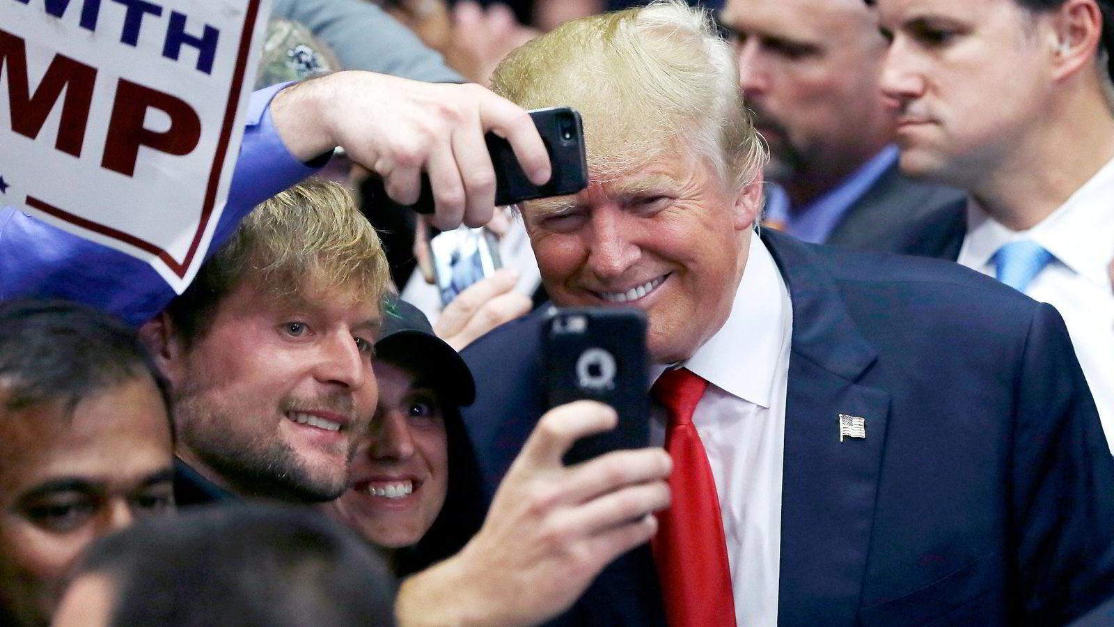 Artikkelforfatteren oppfordrer til å følge Donald Trump i sosiale medier. Foto: Carlos Osorio/AP/NTB Scanpix