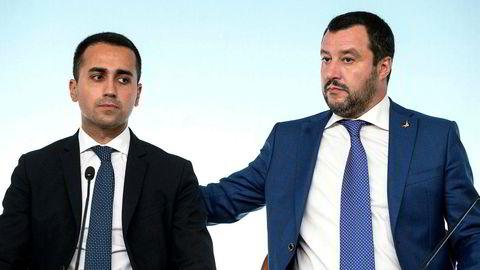 Budsjettet er en seier for de to visestatsministrene – Luigi Di Maio (til venstre) fra Femstjernersbevegelsen  og Matteo Salvini fra partiet Ligaen. De vant over landets uavhengige teknokratiske finansminister Giovanni Tria.