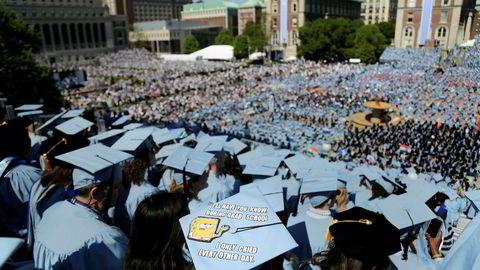 Studenter ved Columbia University ble ferdig med sin utdannelse i mai i år. Nå kan mange amerikanske studenter slippe unna å betale studielånet. Foto: Seth Wenig