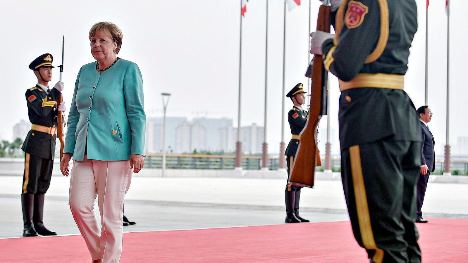 Alle ringer den stadig mektigere Angela Merkel når det er krise internasjonalt. Men på hjemmebane gikk hun på en smell i helgens lokalvalg. Foto: Etienne Oliveau/Reuters/NTB Scanpix