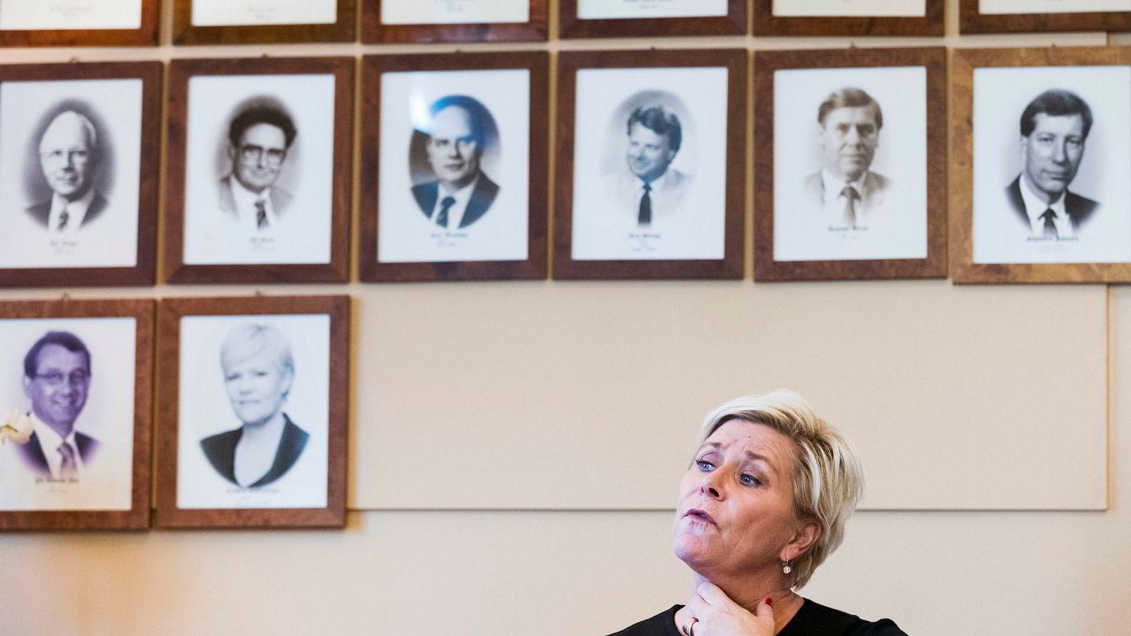 Finansminister Siv Jensen vil senke taket på kommunal eiendomsskatt.