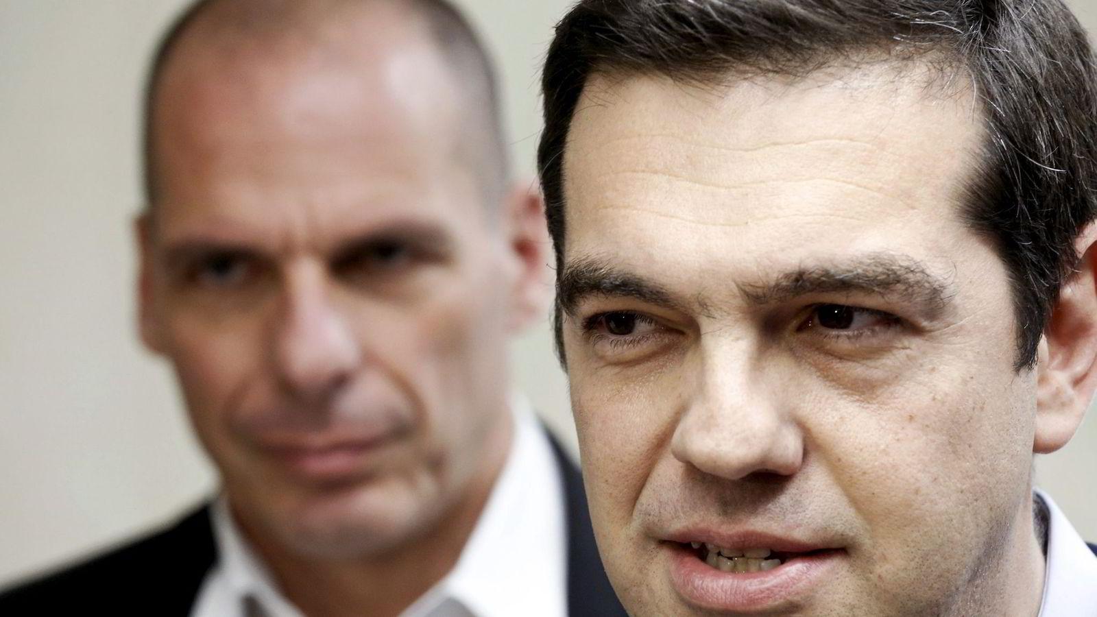 Hellas' statsminister Aleksis Tsipras (til høyre) og finansminister Yanis Varoufakis stenger greske banker og sender kreditorenes forslag til folkeavstemning. Foto: Alkis Konstantinidis, Reuters/NTB Scanpix