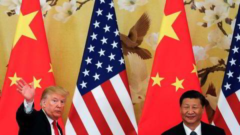 Ekspertene sår tvil om USAs president Donald Trumps sikkerhetsstrategi, der han blant annet langer ut mot Kina og president Xi Jinping (til høyre). Her under et besøk i Beijing sist måned.