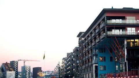 You Hong Bei har akkurat overtatt leiligheten på Sørenga, som ligger i toppetasjen til høyre i dette bygget.