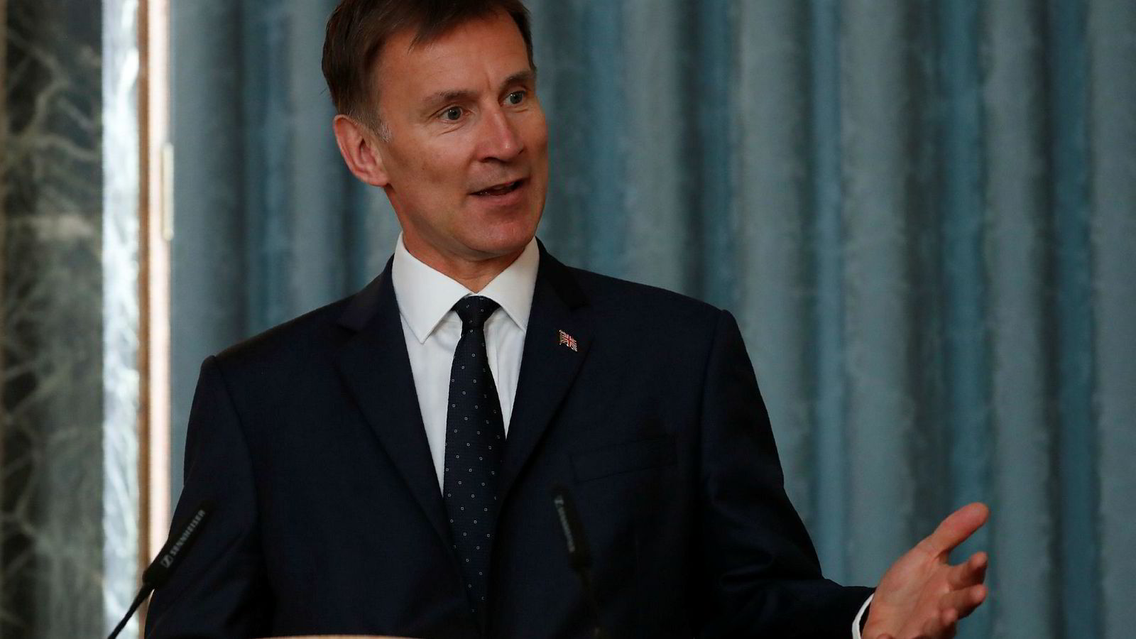 Britain's Foreign Secretary Jeremy Hunt, gestures as he answers a question during a press conference with the Bishop of Truro Philip Mounstephen about the Bishop's final report into the Foreign Office's support for Persecuted Christians around the world, in London, Monday, July 8, 2019. (AP Photo/Alastair Grant, pool)