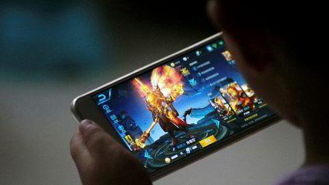Kraftig vekst i reklameinntekter og stor interesse for dataspillet «Honour of Kings» i Kina gjør at Tencent er på vei inn i en eksklusiv klubb – som det eneste selskapet utenfor USA. Foto: Stringer/Reuters/NTB Scanpix