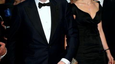 Oligarken. Forretningsmannen, eiendomsmagnaten og kunstsamleren Dmitry Rybolovlev ankommer premieren på filmen «The Great Gatsby» i Cannes sammen med advokat Tetiana Bersheda i 2013.