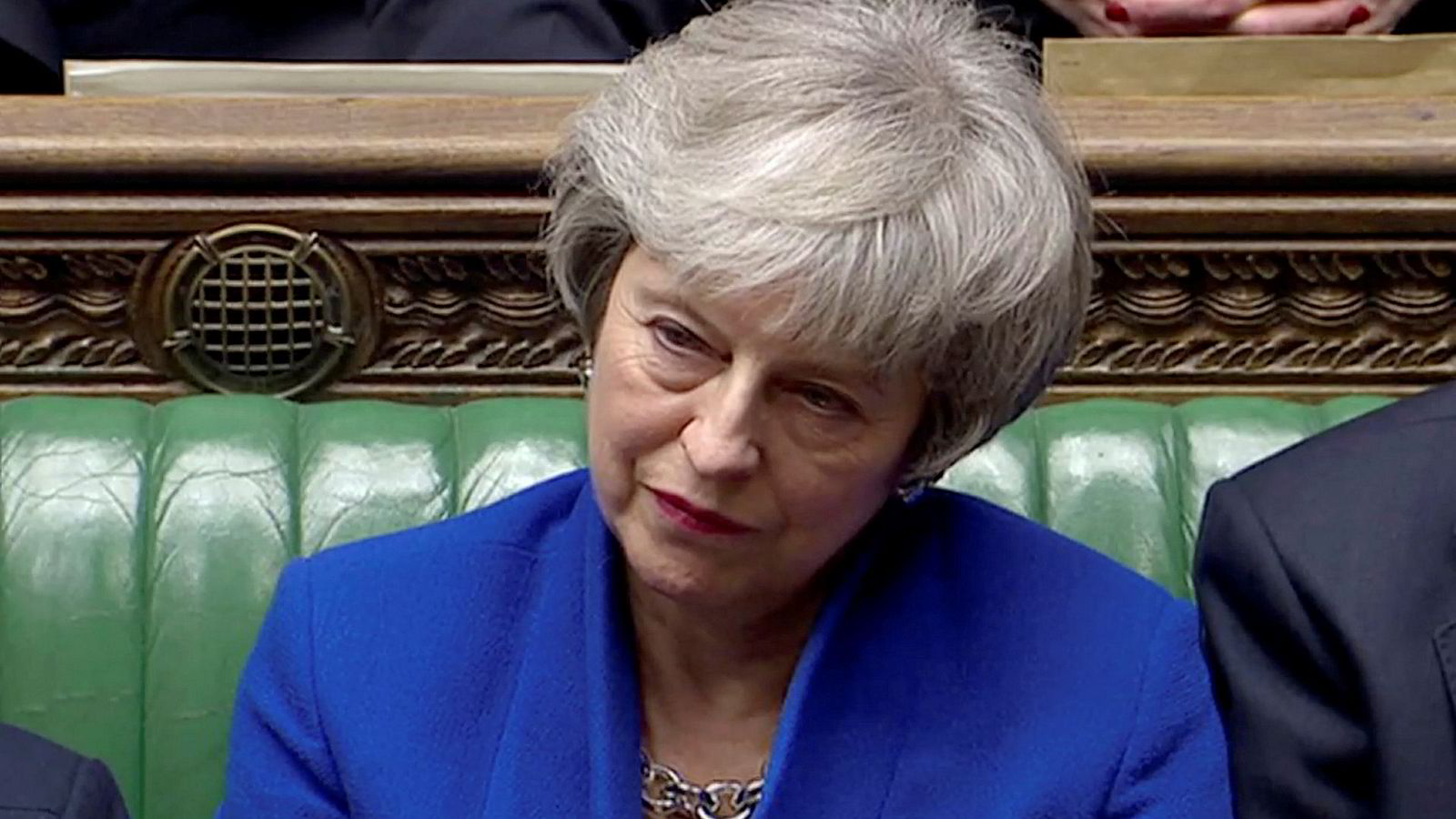 British Prime Minister Theresa May listens as Jeremy Corbyn speaks, after she won a confidence vote, after Parliament rejected her Brexit deal, in London, Britain, January 16, 2019, in this screen grab taken from video. Reuters TV via REUTERS