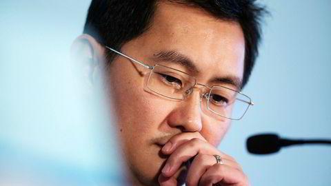 Huateng «Pony» Ma har bygd opp verdens femte største børsnoterte selskap, målt i børsverdi. Kinesiske Tencent passerte en verdi på over 520 milliarder dollar på tirsdag – mer enn Facebook. Veksten forventes å fortsette. Foto: Jerome Favre/Bloomberg