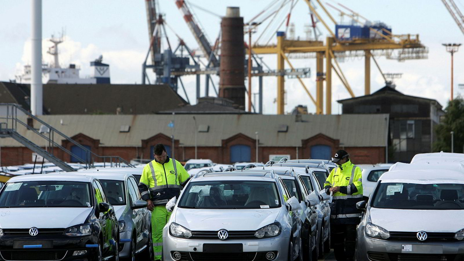 (FILES) This file photo taken on August 31, 2010 shows employees of German logistics company BLG Logistics Group AG controlling rows of German Volkswagen cars at the car terminal at the harbour of Bremerhaven, northern Germany. On February 09, 2017 Germany announced a record trade surplus, with exports of