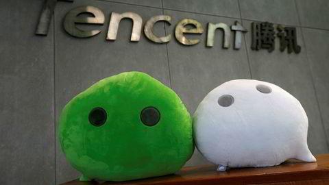 De kinesiske internettselskapene Alibaba og Tencent har rekordresultater og høy vekst. Over 800 millioner brukere er innom Tencents WeChat-tjeneste daglig – de fleste i Kina.  Foto: Bobby Yip/Reuters/NTB Scanpix
