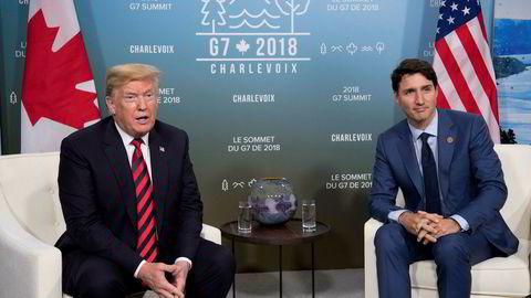 President Donald Trump og Canadas statsminister Justin Trudeau kritiserer Kina. Her fra et møte mellom dem i juni ifjor i forbindelse med G7-toppmøtet i Quebec i Canada.