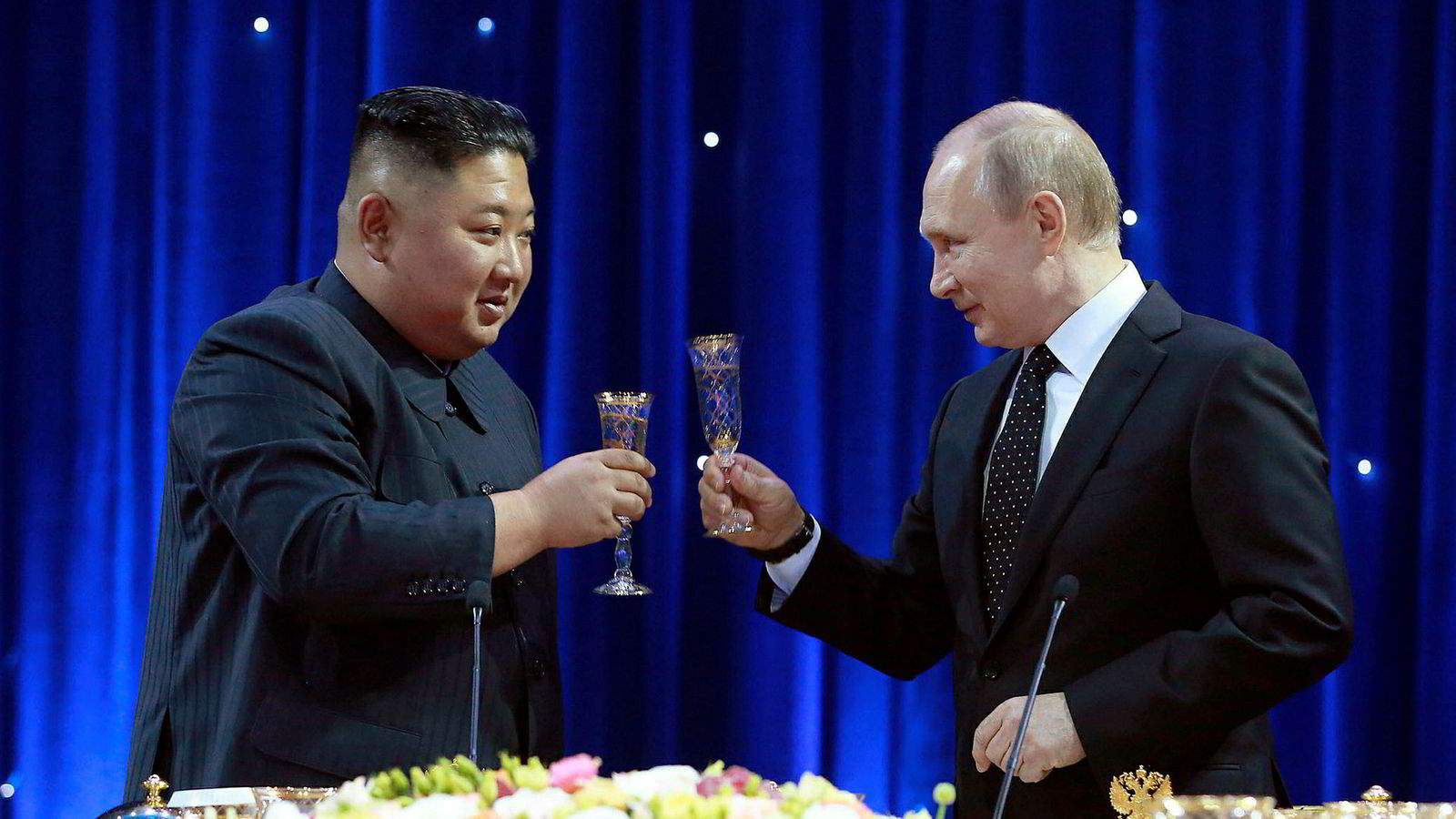 In this Thursday, April 25, 2019, photo provided by the North Korean government, North Korean leader Kim Jong Un, left, toasts with Russian President Vladimir Putin in Vladivostok, Russia. The content of this image is as provided and cannot be independently verified. Korean language watermark on image as provided by source reads: _KCNA_ which is the abbreviation for Korean Central News Agency. (Korean Central News Agency/Korea News Service via AP)